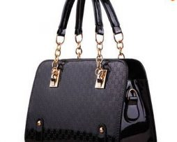 Black handbag with gold chain detailing